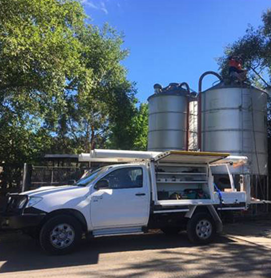 Water tank servicing
